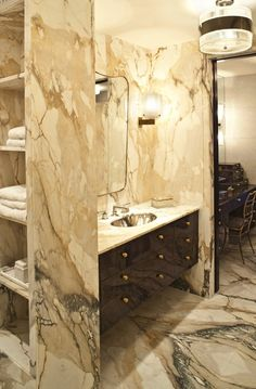 Like the use of stone and contrast between dark and light in this bathroom