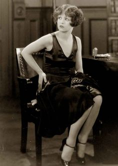 """The impact of this scene in """"IT"""" 1926 cannot be underestimated. Overnight Clara Bow became the world dictator of fashion. The LBD was cemented in peoples minds when Bow wore another LBD in her next movie Rough House Rosie, later that year. Travis Banton went on to become one of Hollywood's leading costumers in the 1930s designing for all the leading ladies. The LBD would not receive such media attention again until Hubert de Givenchys creation for Audrey Hepburn in """"Breakfast At Tiffany's""""…"""