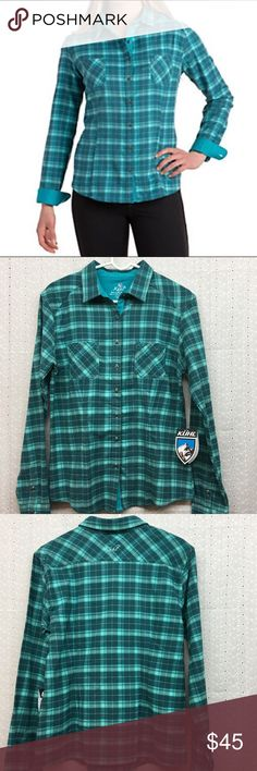 """Kuhl flannel Kuhl """"Klara"""" teal flannel. Technical hollow core fleece traps in heat. Soft Proluxe lining in yolk, collar and cuffs for comfort. Darts for flattering fit. Decorative custom metal buttons. Size L. Armpit to armpit 21"""". Shoulder to bottom hem 26"""". Kuhl Tops"""