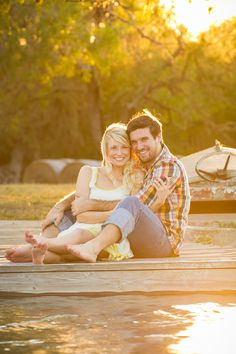 Amy & Justin on a dock as the sun set on their engagement session - www.granolatech.com
