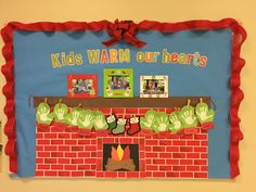 Preschool fireplace bulletin board for Christmas - kids warm our hearts for the holidays