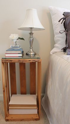 DIY - Fruit Crate turned Night Stand / Bedside Table. Loveee the glass cut to fit the top. Makes it looked finished!