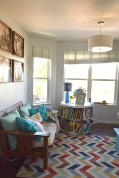 kids play room with bold colors and patterns. Furniture upcycles and creative ways to decorate for a kids space. How to decorate a home with low cost ideas, crafts, DIY and tutorials. To see more visit http://ourhousenowahome.com/ or click on the post