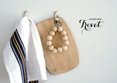 Quick, easy Scandinavian-inspired Wooden Bead Trivet.  All you need is wooden beads and ribbon and a few minutes of your time.