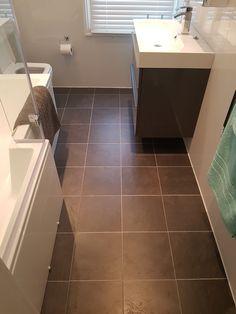 Chocolate brown floor in the bathroom