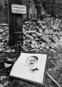 1945: A portrait of Adolf Hitler lies amongst the rubble of a bombed building in Cologne. (Photo by Keystone/Getty Images)