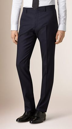 Burberry modern fit suit with a fitted jacket and narrow straight leg trousers in wool woven at the Burberry mill in England. The suit jacket is part-canvassed at the chest with a layer of natural horsehair. Discover men's tailoring at Burberry.com