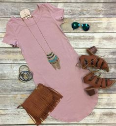 The Fun in the SunTunicDress in Dusty Rose is comfy, fitted, and oh so fabulous! A great basic that can be dressed up or down!  Sizing: Small: 0-3 Medium: 5-