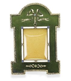 A BELLE ÉPOQUE NEPHRITE AND ENAMEL FRAME, BY CARTIER