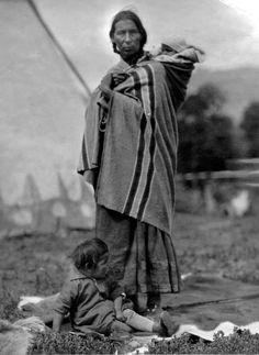 Mrs. Eagle Calf and her children - Blackfeet (Pikuni) - circa 1925