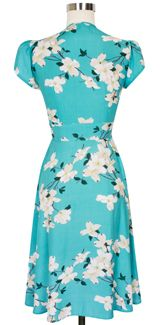 Back at long last, diehard fans will be thrilled to see the Alexa Dress return! Similar to our Ashley Dress, this timeless beauty has a sweet, 1940's feel with its adorable capped petal sleeves. This vintage-inspired design features lightly gathered draping at the underbust line meeting a fitted, top-stitched waist. The hidden side zipper ensures a beautiful silhouette, and the skirt combines straight cut and bias cut panels for a full A-line to the knee. In our light and airy Dogwood print…
