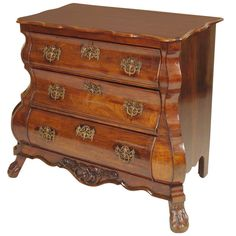 Dutch Bombe Commode  Emailed request for width before flank. Could be very interesting, and might go well enough with marquetry piece.  PRICE:$2,250 Purchase  IN THE STYLE OF:Louis XV PLACE OF ORIGIN:Netherlands DATE OF MANUFACTURE:19th century PERIOD:19th Century MATERIALS AND TECHNIQUES:Wood, Brass MATERIALS NOTES:wood and brass CONDITION:Good. There are 4 patches that are well blended. There is an old age crack on the top, there is no separation of the wood.. HEIGHT:34.5 in. (88…