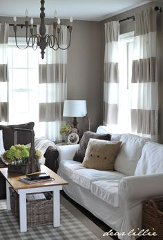 striped drapes. I just love this room. Needs to lose the chandelier and add a ceiling fan. :)
