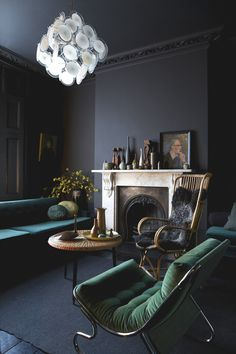 loving all the darkness with touches of light from the chandelier and mantle // Jo Atkins Hughes- London
