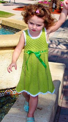 Free knitting pattern for Elenka dress - Inna Aleksandrova's lace toddler dress features a ripple lace skirt with a daisy stitch bodice and eyelet waist for ribbon. Sizes 2T[3T, 4T, 5T] (shown in size 3T)