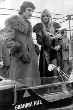 Francois Cevert with Brigitte Bardot at a race car show, Paris, 1971.