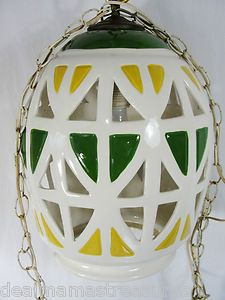 "Vintage 1940s/50s Mid Century Modern Swag Lantern Lamp  HUGE - Approx 16"" tall x 12"" diameter  White, green & yellow ceramic with ""window"" holes  Copper alloy top cap  White enamel on metal chain and wire with plug  Lantern is in excellent, working condition.  A couple fleabite type chips and no cracks.    Chain has some rusting to it, but could be easily replaced    Lantern has no makers marks, but I am told it was brought here from London many years ago.   $230"