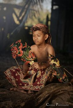 "Performances of shadow puppet theatre are accompanied by gamelan in Java, and by ""gender wayang"" in Bali."