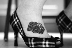 camera tattoo on foot