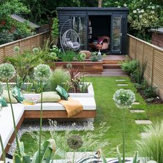Multi-zoned garden makeover with raised beds, summerhouse and dining area