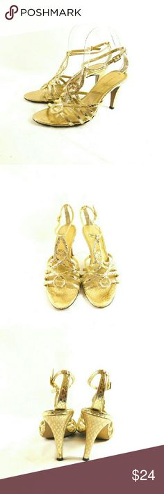 """Tahari Dino Gold Dress Sandals Thanks for checking out my closet. I take all my own pics. The shoes are authentic and in great pre-owned condition. Shoes have a man made upper with 3.75"""" heel. Tahari Shoes Sandals"""