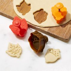 Shop Set of 3 Fall Pie Crust Cutters.  Autumn pie crusts turn over a new leaf with this set of three seasonal cutters.  Spring-action cutters in harvest hues emboss realistic natural details of a maple leaf, oak leaf and acorn when pressed into dough.