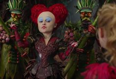 Alice fights a battle against time — literally — in the first trailer for Alice Through the Looking Glass, the sequel to Tim Burton's 2010 fantasia Alice in Wonderland.  The new film sees an older Alice (Mia Wasikowska) return to Underland, only to discover that the land she saved from the vicious Jabberwocky