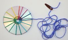 start weaving cds with plastic lid needle