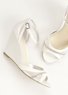 Style meets comfort with this ankle strap wedge featuring a crystal encrusted toe strap!   Heel Height