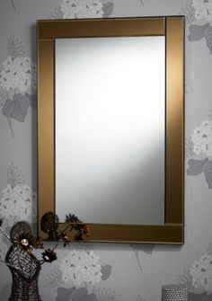 This rectangular mirror features a stylish bronze bevelled glass border. The Modern Art Deco Mirror can be hung portrait or landscape and has fixing points attached to the rear of mirror for easy installation. http://www.chicconcept.co.uk/1640-new-art-deco-bronze-border-rectangular-mirror.html