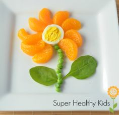 Blooming Breakfast! #hardboiledegg #mandarin oranges #peas #spinach #meals #kids…