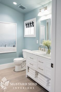 Bathroom Remodel HGTV Dream Home Tour Downstairs bathroom - colors, style of cabinet, roman shade is cute Coastal Bathrooms, Beach Bathrooms, Upstairs Bathrooms, Modern Bathroom Decor, Downstairs Bathroom, Bathroom Renos, Bathroom Interior, Bathroom Shelves, Bathroom Cabinets