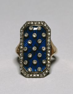 Ring with celestial motif, made in France in the late 18th century (via).