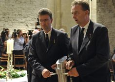 Otto von Habsburg's sons Georg (left) and Karl (right) carry the heart urn during the requiem at the Basilica of the Pannonhalma Abby in Hungary