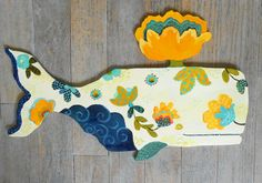 He encontrado este interesante anuncio de Etsy en https://www.etsy.com/es/listing/162393927/lotus-whale-wood-wall-sculpture