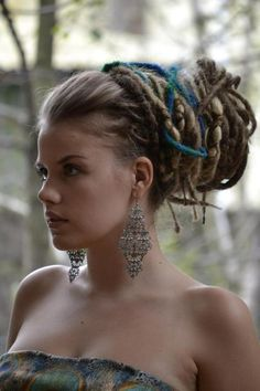 I just love dreads pulled up into a bun. Looks BoHo and it's cool for summer.