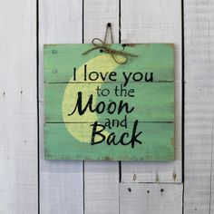 """""""To the Moon and Back"""" Show the special person in your life how much you love them with this unique wooden sign that is great in any room of the house. This reclaimed wood sign measures approximately"""