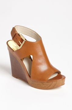 Free shipping and returns on MICHAEL Michael Kors 'Josephine' Wedge (Women) at Nordstrom.com. A wood-look platform refreshes a single-panel sandal set atop a stacked wedge.