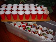 Use plastic cups to organize Christmas ornaments.  Just glue the cups to pieces of cardboard that will find inside your plastic storage totes. This keeps all of your decorations organized and because you can stack two or three cups on top of each other, you can store more in your container.