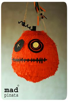 halloween pumpkin piñata created by mad pinata! Halloween, spooky, cute party ideas! #halloweenpumpkinpinata