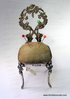 Ornate Silver 'chair' pin cushion hall marked H.W. Chester. 1902. Padded seat to hold the pins.     3ins