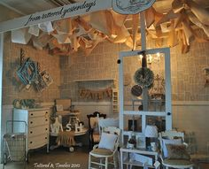great antique mall booth ~ book pages as wall paper, craft aper ceiling, hanging screen door