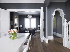 Love the grey walls, white trim with the dark wood floors Living-Room-Greg-Natale's-Payne-House - modern yet totally timeless. The dark grey walls allow those white accents to be a part of the rooms interiors, without any interference. Each design ele Grey Wall Color, Color Yellow, Blue Yellow, Color Black, Dark Wood Floors, Dark Hardwood, Open Plan Living, Open Plan Kitchen Living Room, Room Colors