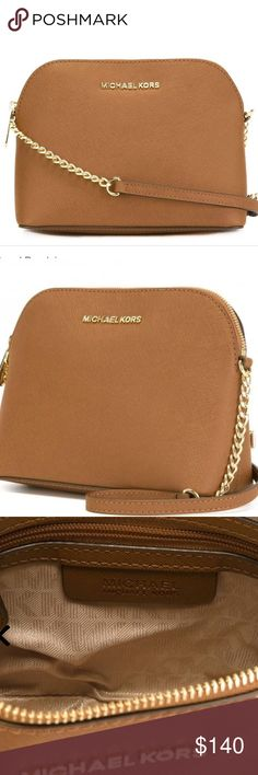 "Michael Kors Large Cindy Crossbody NWT A structured dome silhouette rendered in rich saffiano leather, this MICHAEL Michael Kors crossbody is decidedly sophisticated for a weekend-ready design. Color:TAN Saffiano leather; pocket: polyester Imported Detachable adjustable crossbody strap Zip closure; lined Interior zip pocket, interior slip pocket 8.8""W x 3.5""D x 7""H; 23"" to 25"" strap drop Michael Kors Bags Crossbody Bags"