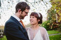 Bride wears a beaded shawl from BHLDN | Photography by http://www.lucylittle.co.uk/