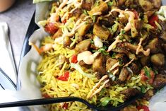 Halal Cart's boldly flavored Middle Eastern Chicken and fragrant Turmeric Rice with a spicy yogurt sauce.