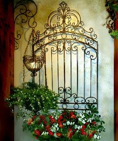 In your Mediterranean outdoor room, create a striking focal point with wrought iron wall art and a large iron Bellagio Wall Basket. Fill the wall basket with spring flowers or Italian cooking herbs.