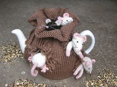 This just is too cute...I drink tea but have never had a tea cozy...maybe the time has come
