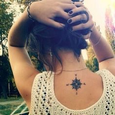 Compass Tattoo on Back of Neck.