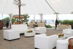 havana nights beach theme party event with lounge furniture by Classic Party Rentals and tent by EventQuip